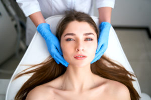 woman deciding between a facelift and botox